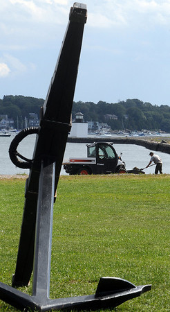 Salem:<br /> Dave Ferrald, gardener, and shoveling is Mark Castro, laborer, both from the National Park Service, clean Derby Wharf beach at the Salem Maritime National Historic Site.<br /> Photo by Ken Yuszkus/Salem News, Tuesday,  September 14, 2010.