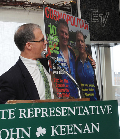 Salem:<br /> John Keenan holds up a poster of Scott Brown and himself on the cover of Cosmopolitan during his annual St. Patrick's breakfast. <br /> Photo by Ken Yuszkus/Salem News, Friday,  March 16, 2012.