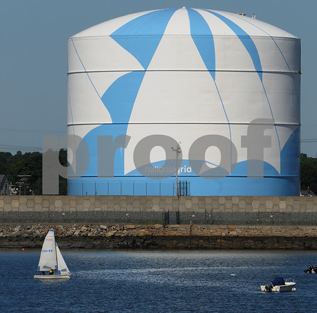 Salem:<br /> A sailboat sails near the large Nationalgrid natural gas storage tank which has the painted stylized sails. <br /> Photo by Ken Yuszkus/Salem News, Wednesday, July 15, 2009.
