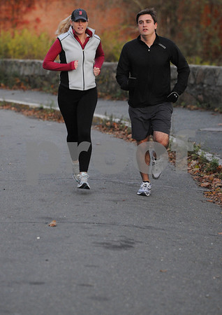 Beverly:<br /> Dan Ritchie and Eileen Moschella are training for the New York City Marathon. They are on route 127 where they ususally run.<br /> Photo by Ken Yuszkus/Salem News, Monday October 19, 2009.