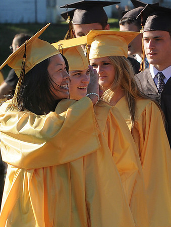 Peabody:<br /> Lan-Anh Nguyen smiles and waves as she passes the crowd at Donaldson Field during the processional at the beginning of the Bishop Fenwick graduation.<br /> Photo by Ken Yuszkus/Salem News, Friday, May 28, 2010