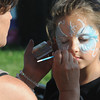 Danvers:<br /> Kyla Estella, right, 6, has her face painted by Sandra Woodring at Plains Park early evening before the start of the fireworks.<br /> Photo by Ken Yuszkus/Salem News, Tuesday, July 3,  2012.