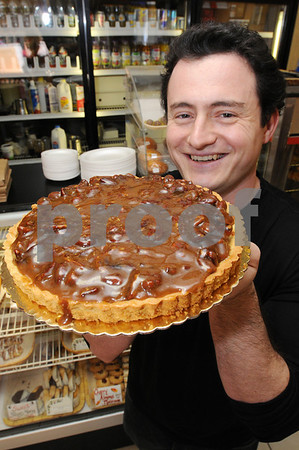 Beverly:<br /> Ilya Tsypkin, general manager of Cassiss Bakery, holds up a pecan pie baked at Cassiss Bakery.<br /> Photo by Ken Yuszkus/Salem News, Monday November 17, 2008.