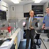 Danvers:<br /> From left, Wayne Marquis, Danvers town manager, speaks with  John Fitzgerald of the Commonwealth of Massachusetts Department of Environmental Protection inside the new $180,000 emergency response vehicle at the Danvers fire station. MassDEP unveiled the high tech emergency response, Field Assessment and Support Team vehicle purchased as a result of the need to respond to the chemical factory explosion in Danvers on Nov. 22, 2006. The FAST vehicle will enable on-scene environmental staff to test air, water and soil contamination to help protect the public during such emergencies.<br /> Photo by Ken Yuszkus/Salem News, Wednesday September 17, 2008.