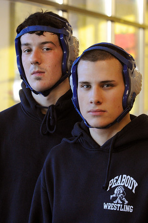 Peaody:<br /> Tyler Giunta, left, and Nick Pigulski, Peabody High wrestling captains at the practice in the school's cafeteria.<br /> Photo by Ken Yuszkus/Salem News, Thursday,  December 9, 2010.