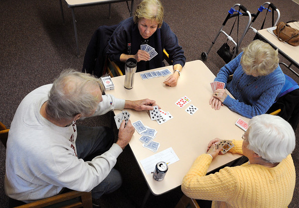 Beverly:<br /> Clockwise from left, Gordon Estee, Mary Jane Gugler, Kathleen Foley, and Anne Flaherty play bridge at the Beverly Senior Center. The social bridge group is looking for more people to participate.<br /> Photo by Ken Yuszkus/Salem News, Thursday, February 2, 2012.