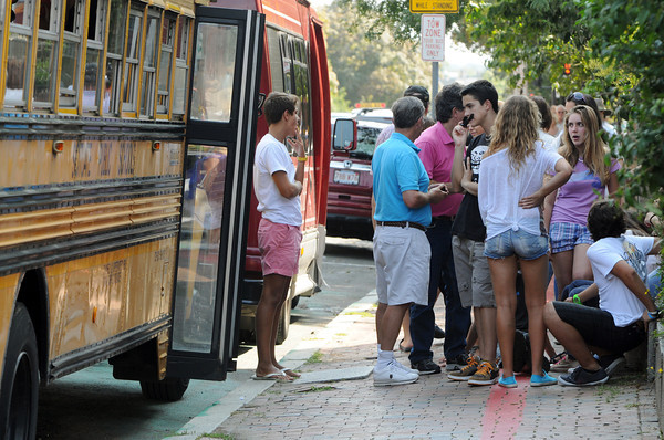 Salem:<br /> Students from Spain linger near their buses on Hawthorne Boulivard. They are with the Scituate High School exchange program.<br /> Photo by Ken Yuszkus/The Salem News, Friday, September 7, 2012.