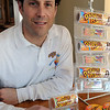 "Beverly:<br /> Marc Cooper holds his new product, ""Doodle Rolls"", a small, portable coloring kit for kids, which is a roll of drawing paper that comes with a set of crayons. <br /> Photo by Ken Yuszkus/Salem News, Friday, March 25, 2011."
