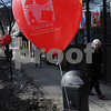 "Beverly:<br /> Hilde Janard of Salem, walks by one of the many balloons attached to the parking meters on Cabot Street. The Promotions Committee tied a red balloon on every parking meter on Rantoul and Cabot Streets and along other streets in the downtown area as part of the ""Painting the Town Red"" promotion to remind everyone that downtown Beverly is a great place to celebrate Valentine's Day!<br /> Photo by Ken Yuszkus/Salem News, Friday,  February 13, 2009."