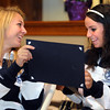 Peabody:<br /> Christa Trombley, left, and Victoria Digiacomo, members of the Peabody High School girls soccer team, look over their citations which they just received. Mayor Bonfanti honored the state champion girls soccer team and gave out citations at Peabody City Hall Thursday morning.  Also, he gave a citation to runners Catarina Rocha and Nick Christensen.<br /> Photo by Ken Yuszkus/Salem News, Thursday, December 15, 2011.