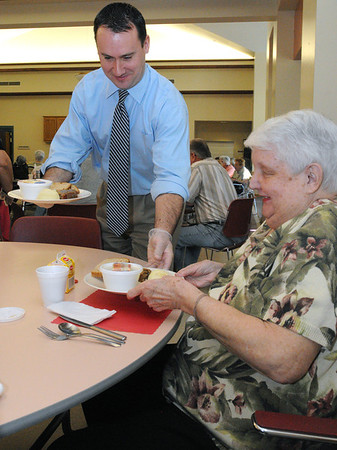 Peabody:<br /> Mayor Ted Bettencourt serves a plate of meatloaf to Cynthia Kolhonen at the Torigian Community Life Center. He was serving meals at the Peabody Council on Aging Mayors for Meals day, an effort to show support for the Meals on Wheels programs along with meals served at area councils on aging. Significant cuts have been proposed to these programs by the governor in his state budget.<br /> Photo by Ken Yuszkus/Salem News, Wednesday,  March 21, 2012.