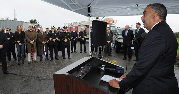 Middleton:<br /> Sheriff Frank Cousins begins with opening remarks at the Essex County Regional Emergency Communications Center ground breaking ceremony.<br /> Photo by Ken Yuszkus/Salem News, Tuesday, October 4, 2011.