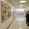 Salem:<br /> Nicole Mignault, left, and Sarah Pensyl, both seniors, exam the various art on the hallway wall during the Salem High School annual Deck The Halls Art Exhibit at the shool. Students showcased their photography, graphic design, drawing, painting, sculpture, tv production/digital media, and woodworking.<br /> Photo by Ken Yuszkus/Salem,  News, Wednesday,  December 22, 2010.