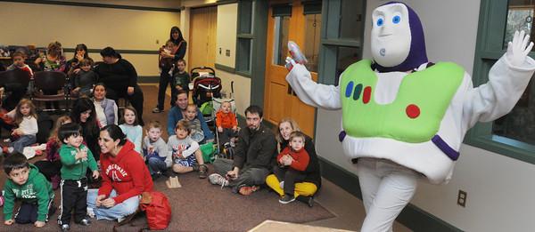 Hamilton:<br /> Buzz Lightyear greets the crowd at the start of the Buzz Lightyear Story Time at the Hamilton- Wenham Public Library on Tuesday morning.<br /> Photo by Ken Yuszkus/Salem News, Tuesday, April 3, 2012.