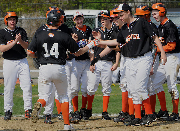 Hamilton:<br /> Ipswich's Nathaniel Bocko is greeted with cheers as he comes home after hitting a homerun that brought in two other runners during the Ipswich at Hamilton-Wenham baseball game at Patton Park.<br /> Photo by Ken Yuszkus/Salem News, Thursday, April 22, 2010.