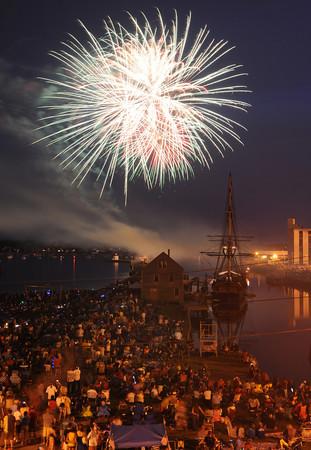 Salem:<br /> Fireworks over Salem Harbor viewed from the Custom House.<br /> Photo by Ken Yuszkus/Salem News, Wednesday, July 4,  2012.
