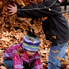 Salem:<br /> Aidan Blot, 5, is about to drop an armload of leaves onto his sister, Sawyer Call, 2, while playing in the fallen leaves at Salem Common on Monday afternoon. Aidan and Sawyer are from Salem.<br /> Photo by Ken Yuszkus/Salem News, Monday, November 21, 2011.
