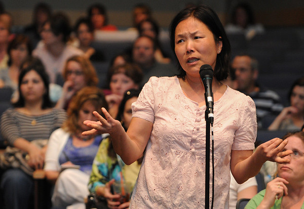 Topsfield:<br /> Mia Cloonan speaks from the audience at Masconomet Regional High School during the informational forum concerning the bullying problem at the Fuller Meadow School.<br /> Photo by Ken Yuszkus/Salem News, Wednesday, April 7, 2010.