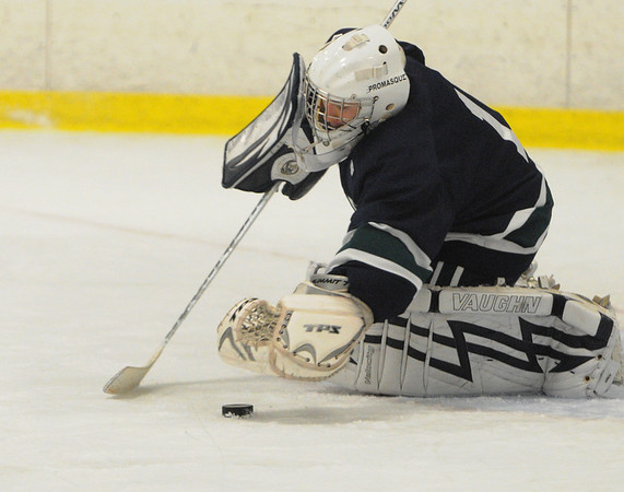 Hamilton:<br /> Pingree's goalie Scott Caradonna pounces on the puck for a save at the Pingree School boys hockey season opener vs. Belmont Hill.<br /> Photo by Ken Yuszkus/Salem News, Wednesday, Decmber 2, 2009.