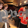 Salem:<br /> From left, Lee Accomando and Christopher Pensyl, both Salem High students, listen to Judith Ternes, a graduate from Salem High and now a sophmore at Cornell University, speak about Cornell University at the high school Alumni College Fair.<br /> Photo by Ken Yuszkus/Salem News, Thursday,  January 8, 2009.