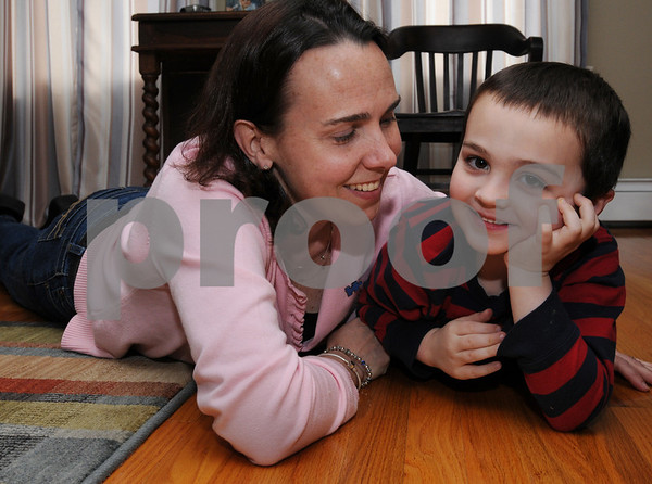 Beverly:<br /> Dawn Coback and her son, Jake, play on the floor of their home. Jake was diagnosed with autistm as a baby, and the family spent tens of thousands of dollars to pay for therepy, which has really made a difference. Now, she started a nonprofit organization to give other families that can't afford it a chance to have the therapy. <br /> Photo by Ken Yuszkus/Salem News, Wednesday, April 8, 2009.