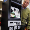 Salem:<br /> Jim Hacker, executive director of the Salem Parking Department, stands near a new type of parking meter that will be installed at a few locations next week.<br /> Photo by Ken Yuszkus/Salem News, Wednesday November 18, 2009.