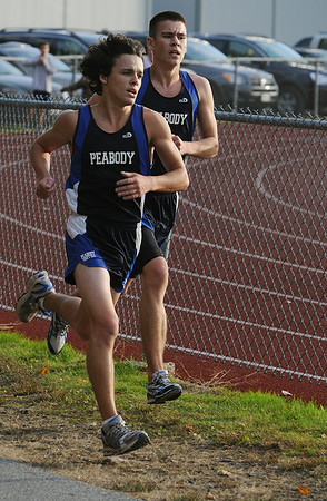 Peabody:<br /> Nick Christensen finishes first in front of fellow Peabody High runner, Keane Terenzoni, in the last few hundred feet of the boys race, during the Beverly at Peabody cross country meet.<br /> Photo by Ken Yuszkus/Salem News, Tuesday,  October 26, 2010.