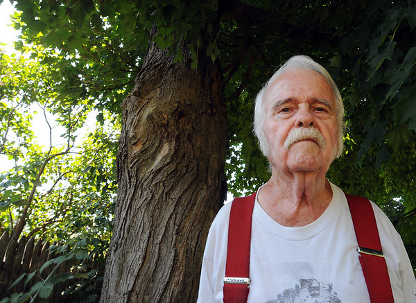 Wenham:<br /> Harold Boothroyd, is retiring after 40 years as the Wenham's lumber surveyor and measurer of tree and bark. He is standing near a large maple tree in his backyard.<br /> Photo by Ken Yuszkus/Salem News,Thursday, July 8, 2010.