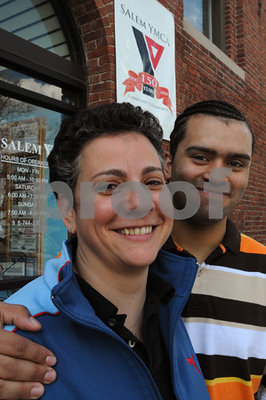 Salem:<br /> Debbie Amaral was named Foster Parent of the Year for this region by the Department of Children and Families. Her son, Jose Rivera, stands next to her in front of the Salem YMCA. She is the Executive Director of the Salem YMCA.<br /> Photo by Ken Yuszkus/Salem News, Friday, April 10, 2009.