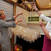 Wenham:<br /> Gracyn Whitman, left, and Kathy Marshall, of Marshall/Whitman, decide where the chandelier is to be hung while building their vignette for the upcoming North Shore Design Show at the Wenham Museum.<br /> Photo by Ken Yuszkus/Salem News, Tuesday, May 10, 2011.