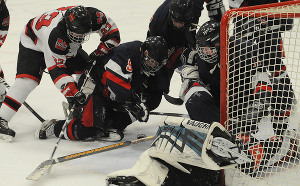Cambridge:<br /> Marblehead's Austin Haley, left, repeatedly tries to put the puck into the net while in front of it in the first period during the Marblehead vs Pembroke division 3 state semifinals at Bright Center at Harvard University.<br /> Photo by Ken Yuszkus/Salem News, Tuesday March 15, 2011.