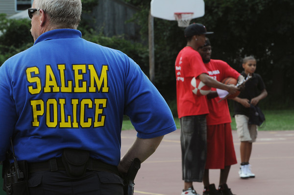 Salem:<br /> Salem police watch over the Fourth of July activities at the Palmer Cove playground.<br /> Photo by Ken Yuszkus/Salem News, Wednesday, July 4,  2012.