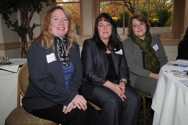Salem:<br /> From left, Melody Bohl of Ladies Who Launch, Diane Gokas of Beverly Cooperative Bank, and Lenna Shulga of Willowdale Estate attend the 6th Annual Million Dollar Women Symposium held at the Hawthorne Hotel.<br /> Photo by Ken Yuszkus/Salem News, Wednesday,  November 3, 2010.