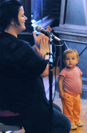 Peabody:<br /> Lily Freitas, 16 months old, listens attentively to singer/song writer Charlie Hope perform at the Peabody Institute Library Tuesday morning.<br /> Photo by Ken Yuszkus/Salem News, Tuesday, April 17, 2012.