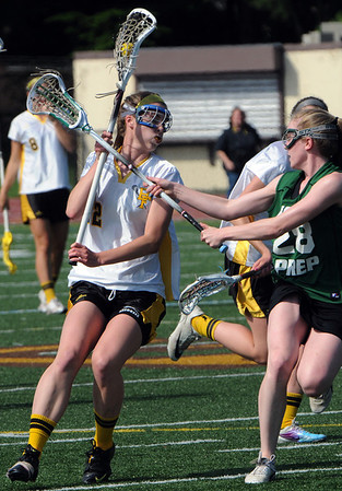 Peabody:<br /> Lauren Moulton gets battered by an Austin Prep player durintg the Austin Prep at Bishop Fenwick girls lacrosse Division 2 North first round state tournament game<br /> Photo by Ken Yuszkus/Salem News, Tuesday, May 31, 2011.