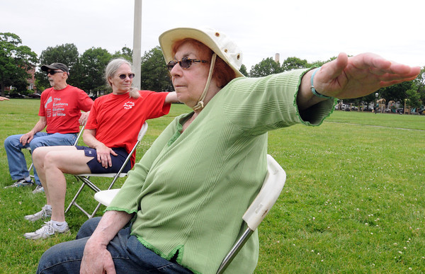 Salem:<br /> From left, Michael Pelletier, his wife Anne Pelletier, and Sara Gamble take part in the chair yoga portion of the Fitness Day at the Salem Common. It was presented by The Salem Council on Aging . This was the first year that Fitness Day was held in the common. The hours were from 9am to 1pm.<br /> Photo by Ken Yuszkus/Salem News, Wednesday, May 30, 2012.