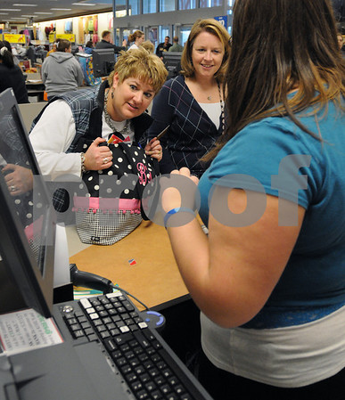 Danvers:<br /> Marilyn Deschenes, left, checks the prices on the screen at the check out counter at Kohl's department store. Friend, Debbie Petroccione watches over her shoulder as the bargins that they found are rung up. Black Friday sent shoppers swarming the stores looking for bargains.<br /> Photo by Ken Yuszkus/Salem News, Friday November 28, 2008.