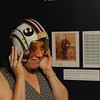 Wenham:<br /> Carolyn Nenart, education director at the Wenham Museum tries on a helmet on display from the movie Star Wars at the new exhibit at the Wenham Museum.<br /> Photo by Ken Yuszkus/Salem News, Thursday, June 16, 2011.