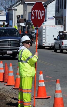 Salem:<br /> Kelley Graham works as a flagger on Bridge Street.<br /> Photo by Ken Yuszkus/Salem News, Thursday, April 1, 2010.