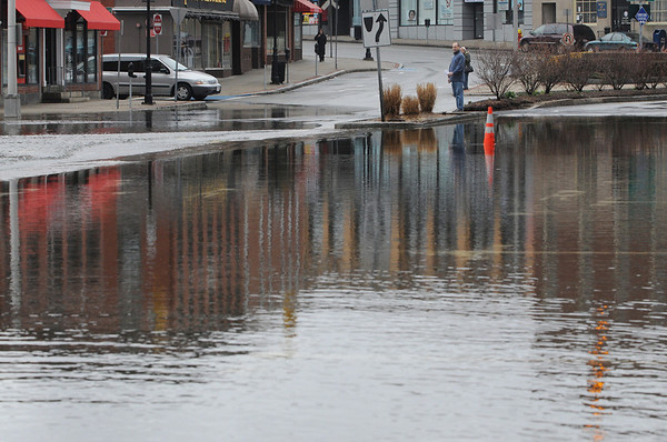 Peabody:<br /> People gathered to view the high water in Peabody Square created by the heavy rainfall. This is Central Street.<br /> Photo by Ken Yuszkus/Salem News, Wednesday, March 31, 2010.