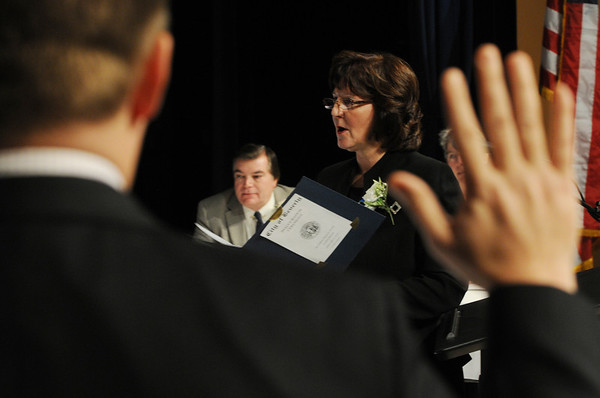 Beverly:<br /> Kathleen Connolly, Beverly city clerk, gives the oath of office to the city council on the stage during the inauguration ceremony at Beverly High School.<br /> Photo by Ken Yuszkus/Salem News, Tuesday, January 3, 2011.