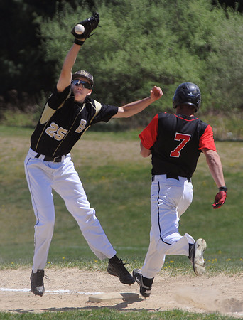 Peabody:<br /> Bishop Fenwick's first baseman Cam Borerelli reaches for the throw as North Andover's Bobby Trickett arrives safe during the North Andover at Bishop Fenwick baseball game. <br /> Photo by Ken Yuszkus/Salem News, Wednesday, April 18, 2012.