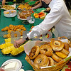 Salem:<br /> Student Alesio Kanani of Salem, reaches for some pineapple during the Salem Academy Charter School Honors Brunch. The brunch is to recognize students who have a 95 percent  average across all of their classes.<br /> Photo by Ken Yuszkus/Salem News, Wednesday, July 1, 2009.