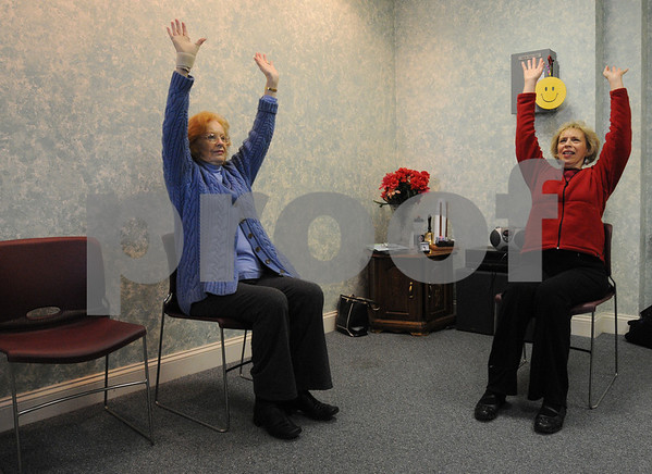 Middleton:<br /> Dot McKeen, right, starts the laughter yoga class at the Middleton Coucil on Aging. Barbara Rhuda, left,  is a participant.<br /> Photo by Ken Yuszkus/Salem News, Friday,  January 16, 2009.
