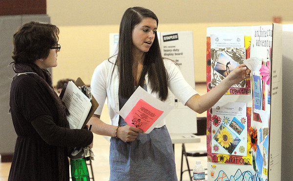 Boxford:<br /> Shannon Murphy, left, one of the judges, speaks to Claudia Marsh, freshman, about her project during the Annual Architecture Fair.<br />  at Masconomet High School.<br /> Photo by Ken Yuszkus/Salem News, Thursday, May 13, 2010.