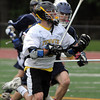 Peabody:<br /> Bishop Fenwick's Andrew Ruby lost the ball but immediately regains it during the St. Mary's of Lynn at Bishop Fenwick boys lacrosse game.<br /> Photo by Ken Yuszkus/Salem News, Monday, May 14, 2012.