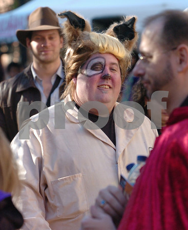 Salem:<br /> Peter Trumpf of Long Island, New York, strolls down Essex Street in costume in the afternoon. Thousands are expected to descend upon Salem tonight for Halloween.<br /> Photo by Ken Yuszkus/Salem News, Friday, October 31, 2008.