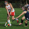 Topsfield:<br /> Masconomet's Brooke Stewart, left, and Hamilton-Wenham's Liviy Ambrose fight for control of the ball at the Hamilton-Wenham at Masconomet field hockey game.<br /> Photo by Ken Yuszkus/Salem News, Tuesday, October 11, 2011.