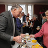 Salem:<br /> Dale Gephart serves a cup of bouillon to Mary Ann Woodward at Hamilton Hall before the speaker begins at the lecture series.<br /> Photo by Ken Yuszkus/Salem News, Thursday, February 17, 2011.