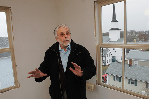 Peabody:<br /> Don Preston is inside the cupola of one of the two new units built by Habitat for Humanity at 5 Park Street.<br /> Photo by Ken Yuszkus/Salem News, Monday, April 4, 2011.